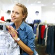 Woman in a shop buying clothes — Stock Photo