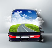 Red suitcase with landscape and road inside — Stock Photo