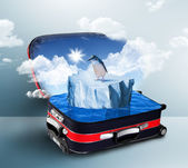 Red suitcase with iceberge inside — Stock Photo