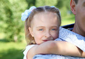 Father and daughter in the summer park — Stock Photo