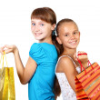 Pretty teenage girls with shopping bags — Stock Photo #6552600