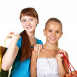 Pretty teenage girls with shopping bags — Stock Photo #6579847