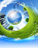 Green planet against blue sky and clean nature — Stok fotoğraf