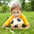 Little boy in the park with a ball — Stock Photo