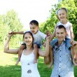 Family with two children in the summer park - Foto Stock