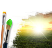 Paintbrushes and landscape — Stock Photo
