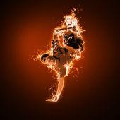 Fire dancer against black background — Stock Photo