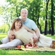 Young couple on picnic in the park — Stock fotografie