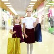 Stock Photo: Little girl doing shopping