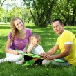 Parents in the summer park - Stock Photo