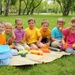 Stock Photo: Group of children sitting together in the park