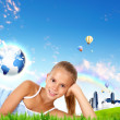 Stock Photo: Girl against green natural landscape