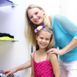 Stock Photo: Young mother and her daughter doing shopping