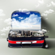 Red suitcase with city inside - Stockfoto