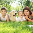 Mother and her two sons in the park with a dog — Stock Photo