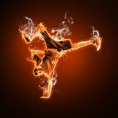 Fire dancer against black background — Stock Photo