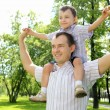 Father with his son in the park - Foto Stock