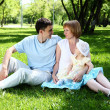 Young family together in the park — Stock Photo #6634873