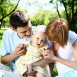 Stock Photo: Young family together in the park
