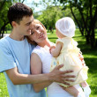 Young family together in the park — Stock Photo #6635084
