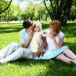 Young family together in the park — Stock Photo #6635238