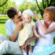 Young family together in the park — Stock Photo #6635362