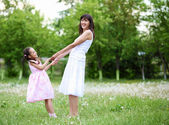 Young mother and her young daughter — Stock Photo