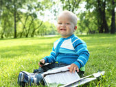 Portrait of little baby boy in the park — Stockfoto