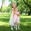 Stock Photo: Two little sisters in the summer park