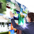 Man working with vurtial screens — Stock Photo #6644091