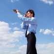 Young business man looks through a telescope — Stock Photo #6692282