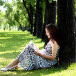 Portrait of pregnant woman in the park — Stok fotoğraf