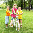 Girls with a bike in the park — Stock Photo #6692369
