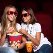 Two young girls watching in cinema — Photo