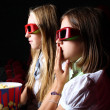 Two young girls watching in cinema — Stock Photo #6692719