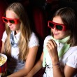 Stock Photo: Two young girls watching in cinema