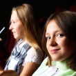 Zdjęcie stockowe: Two young girls watching in cinema