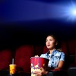 Young girl in cinema — Stock Photo