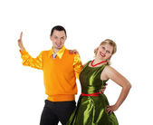 Young dancing couple in bright colour wear — Stock Photo