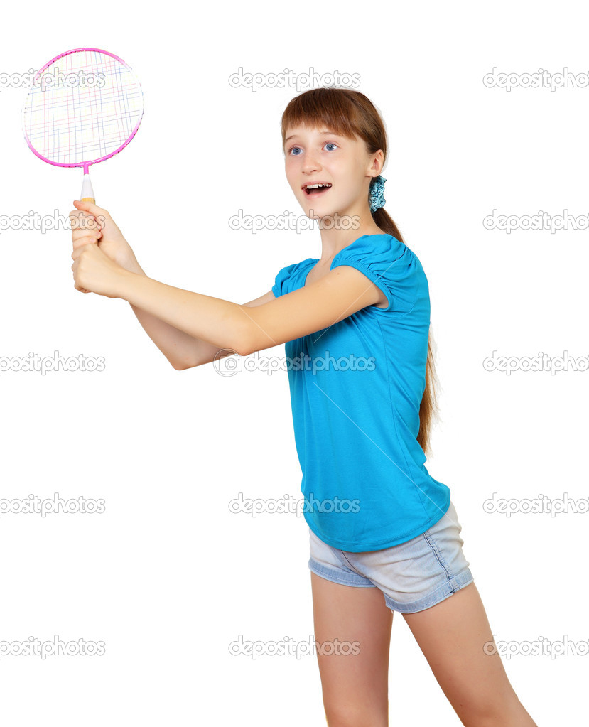 Pretty teenage girl with racket in studio on white background  Stock Photo #6692017