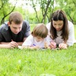Family together in the park — Stockfoto