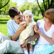 Young family together in the park — Stock Photo #6706662