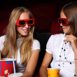 Two young girls watching in cinema — Stock Photo #6706757