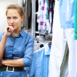 Woman in a shop buying clothes — Stock Photo #6706903