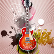 Guitar against decorative background — Stock Photo #6707376