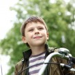 Boy on a bicycle in the green park - Lizenzfreies Foto