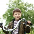 Boy on a bicycle in the green park - Foto de Stock