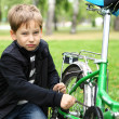 Boy on a bicycle in the green park — Stock Photo #6707619