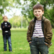 Boy with a friend in the green park — Stock Photo #6707651