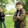 Stock Photo: Boy with a friend in the green park